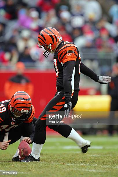 Shayne Graham of the Cincinnati Bengals attempts a field goal from the hold of Kyle Larson during the game against the New England Patriots at...