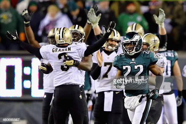 Shayne Graham of the New Orleans Saints celebrates with teammate Benjamin Watson after kicking the game winning field goal to defeat the Philadelphia...
