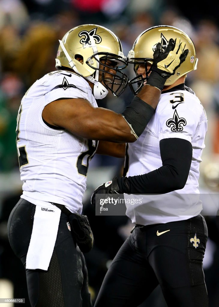 Shayne Graham #3 of the New Orleans Saints celebrates with teammate Benjamin Watson #82 after kicking the game winning field goal to defeat the Philadelphia Eagles in their NFC Wild Card Playoff game at Lincoln Financial Field on January 4, 2014 in Philadelphia, Pennsylvania. The New Orleans Saints defeated the Philadelphia Eagles 26 - 24.