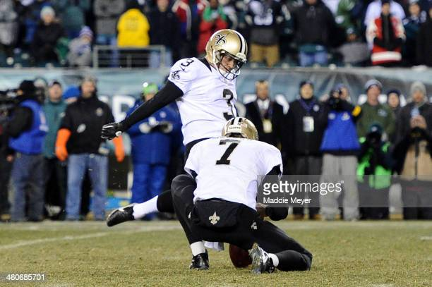 Shayne Graham of the New Orleans Saints kicks a 32 yard game winning field goal to defeat the Philadelphia Eagles in their NFC Wild Card Playoff game...