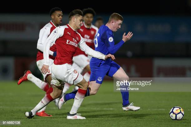 Shayne Lavery of Everton escapes a challenge from Konstantinos Mavropanos of Arsenal during the Premier League 2 match between Arsenal and Everton at...