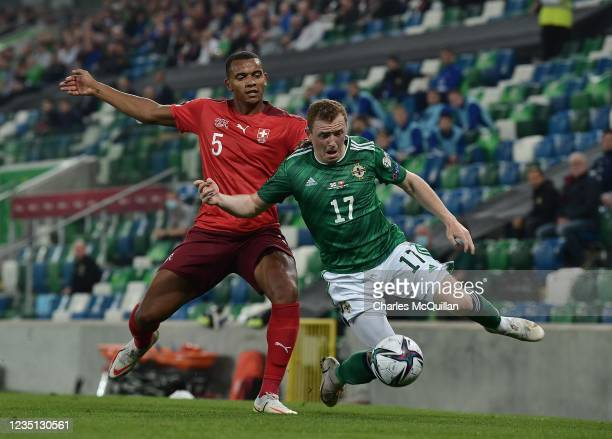 Shayne Lavery of Northern Ireland and Manuel Akanji of Switzerland during the 2022 FIFA World Cup Qualifier match between Northern Ireland and...