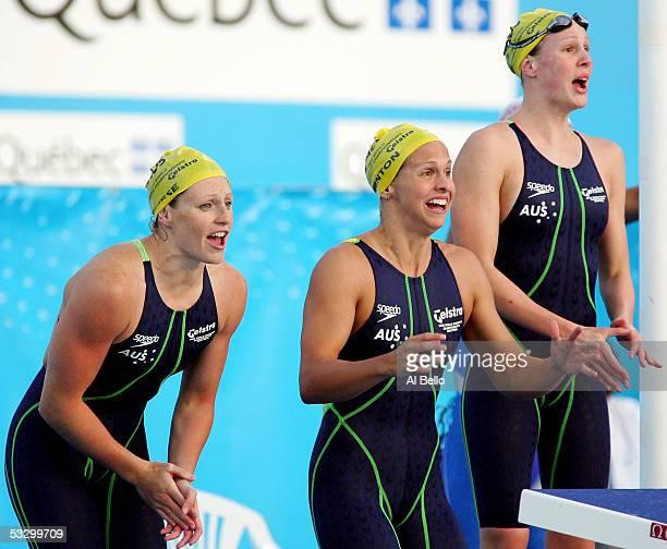 Shayne Reese Lisbeth Lenton and Bronte Barratt of Australia cheer during the final leg of the 4x200 meter Freestyle relay final during the XI FINA...