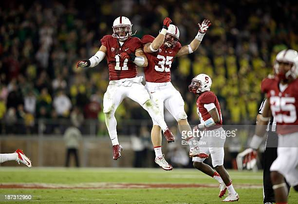 Shayne Skov and Jarek Lancaster of the Stanford Cardinal celebrate after Lancaster recovered a fumble during their game against the Oregon Ducks at...