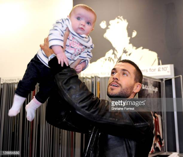 COVERAGE ** Shayne Ward greets young fan LexiJoy Dunleavy while promoting his new album 'Obsession' at HMV on November 15 2010 in Manchester England