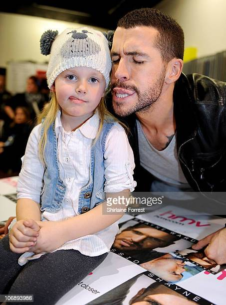 COVERAGE ** Shayne Ward pulls a funny face with a young fan while promoting his new album 'Obsession' at HMV on November 15 2010 in Manchester England