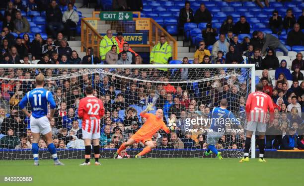 Shayne Ward scores from the penalty spot during the Bradley Lowery charity match at Goodison Park Liverpool
