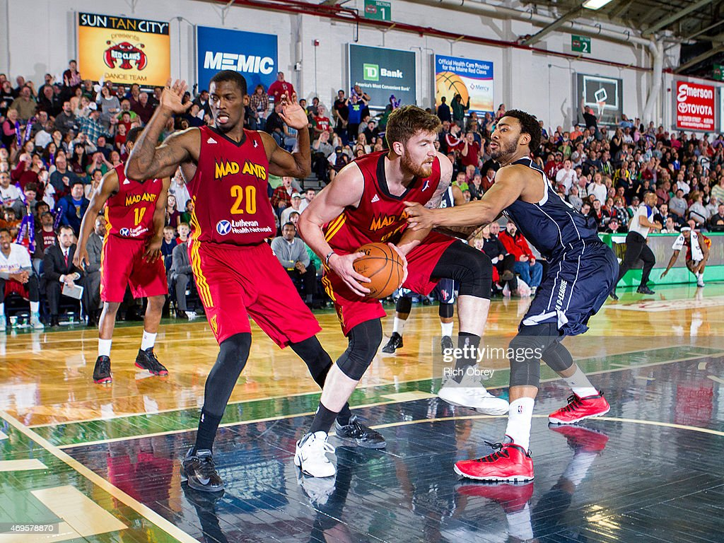 Shayne Whittington #32 of the Fort Wayne Mad Ants controls a rebound under pressure from James Young #13 of the Maine Red Claws during Playoff Game #2 on April 11, 2015 at the Portland Expo.