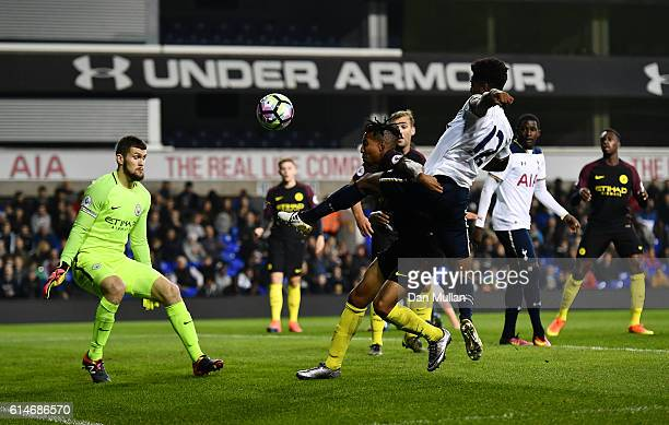 Shayon Harris of Tottenham Hotspuron takes a shot at goal under pressure from Demeaco Duhaney of Manchester City during the Premier League 2 match...