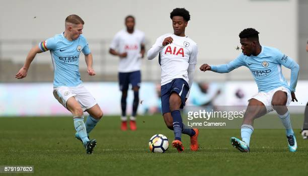 Shayon Harrison and Jacob Davenport and Tom DeleBashiru of Manchester City during the Premier League 2 at The Academy Stadium on November 25 2017 in...
