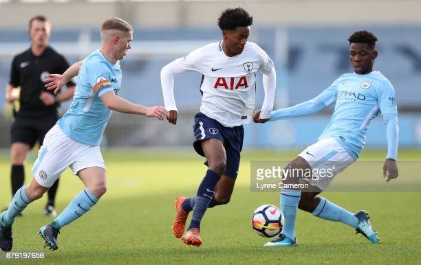 Shayon Harrison of Tottenham Hotspur an dJacob Davenport and Tom DeleBashiru of Manchester City during the Premier League 2 at The Academy Stadium on...