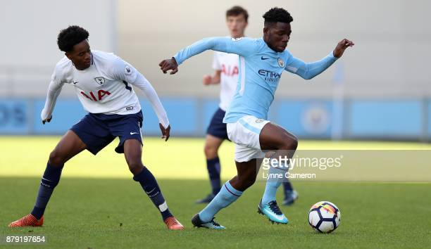 Shayon Harrison of Tottenham Hotspur and Tom DeleBashiru of Manchester City during the Premier League 2 at The Academy Stadium on November 25 2017 in...