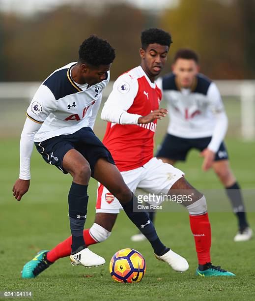 Shayon Harrison of Tottenham Hotspur is challenged by Gedion Zelalem of Arsenal during the Premier League 2 match between Tottenham Hotspur and...