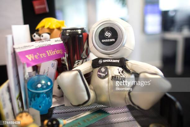 A Shazam Entertainment Ltd branded toy sits on a desk at the company's headquarters in London UK on Friday July 26 2013 Billionaire Carlos Slim's...