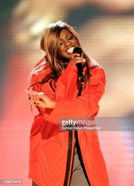 Shaznay Lewis of the British girl group All Saints performing during the Brit Awards at the London Arena in London England on February 9 1998