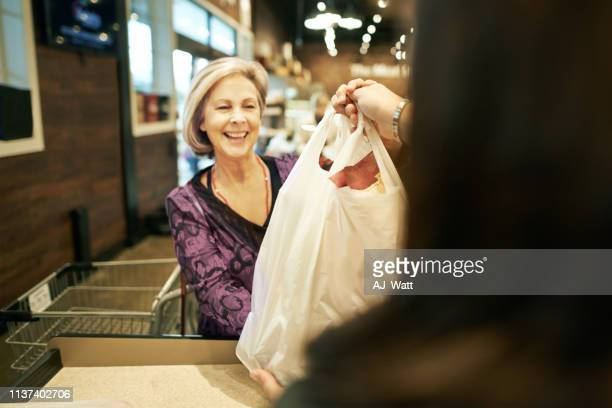 she always leaves with a smile on her face - bag stock pictures, royalty-free photos & images