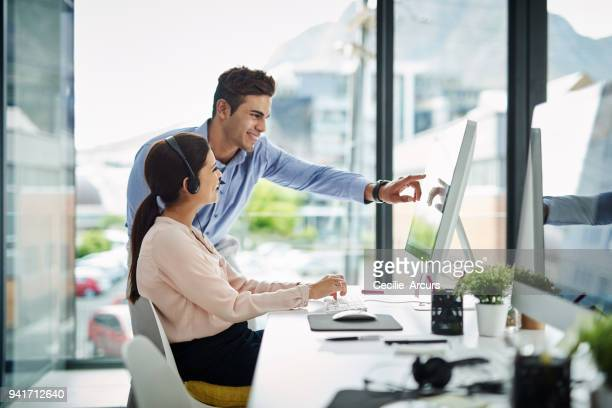 she appreciates his interpersonal skills and so do her customers - happy computer headset stock pictures, royalty-free photos & images