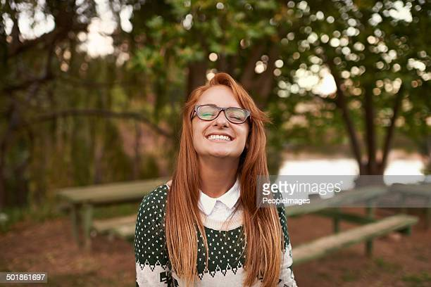 she appreciates the small things in life - geek girl stock photos and pictures