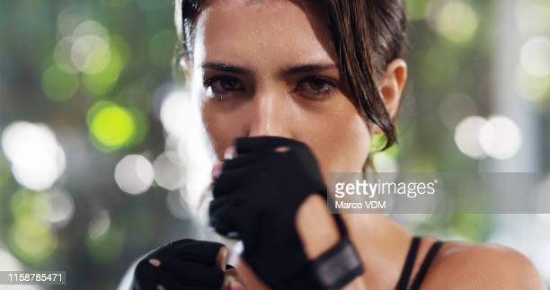 she believes in the importance of self defence - resilience stock photos and pictures