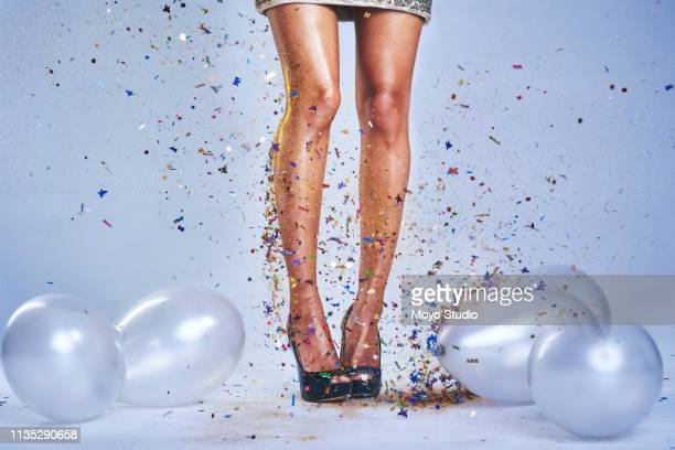 she brings the party - beautiful legs in high heels stock pictures, royalty-free photos & images