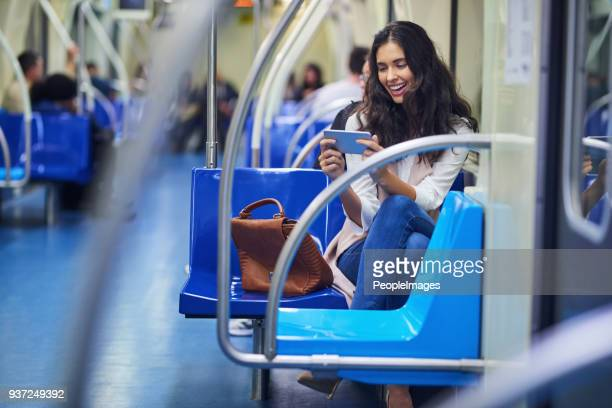 she can binge on shows while commuting - commercial land vehicle stock pictures, royalty-free photos & images