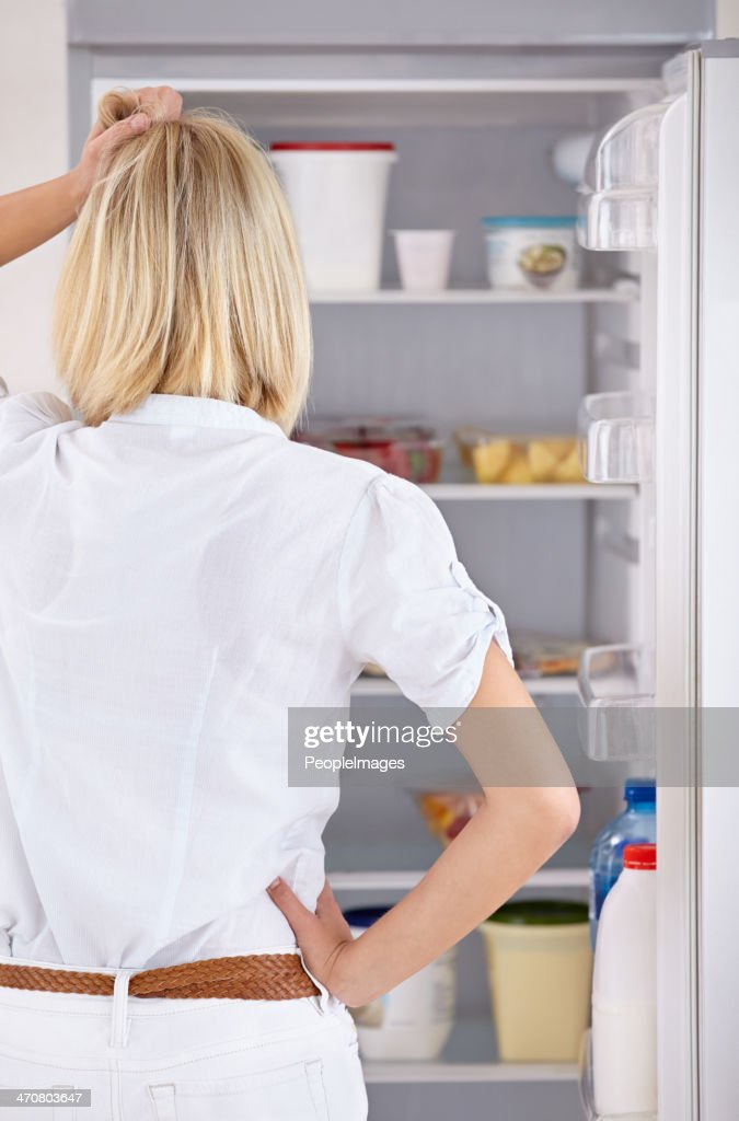 She Cant Decide What To Eat Stock Photo - Getty Images