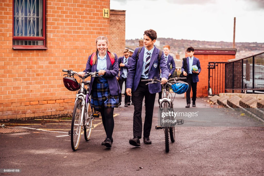 She Cycles to School and Back : Stock Photo