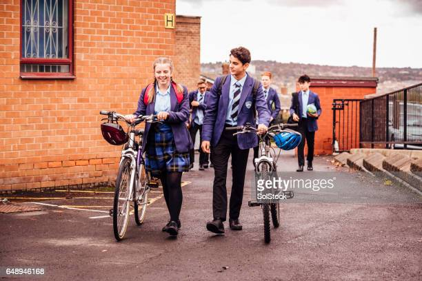 she cycles to school and back - school children stock photos and pictures