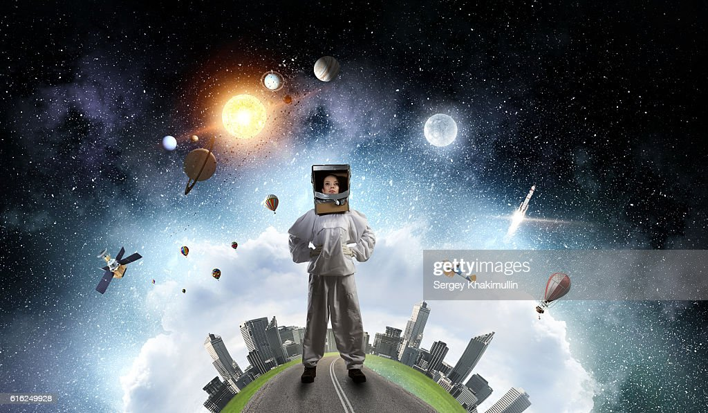 She dreams to explore space . Mixed media : Stock Photo
