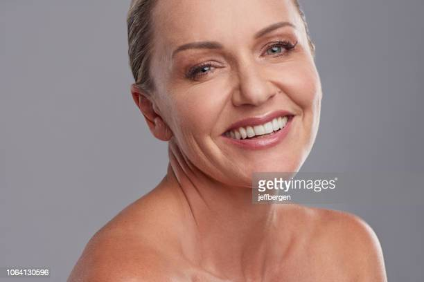 she embraces getting older with ease - strapless stock pictures, royalty-free photos & images