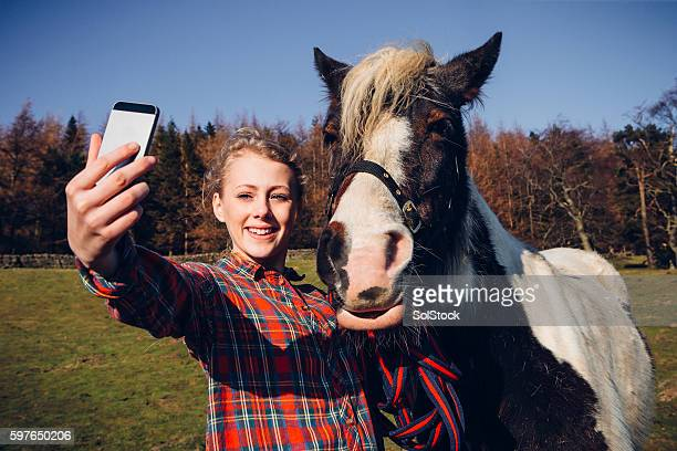 She enjoys taking selfies with her horse