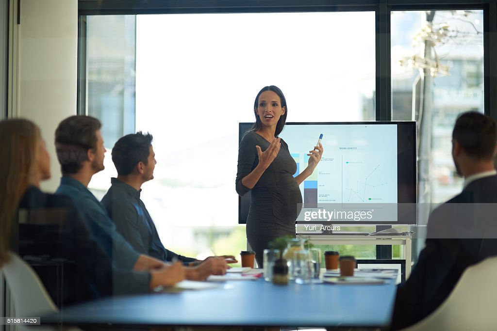 She excels in the boardroom in every way : Stock Photo
