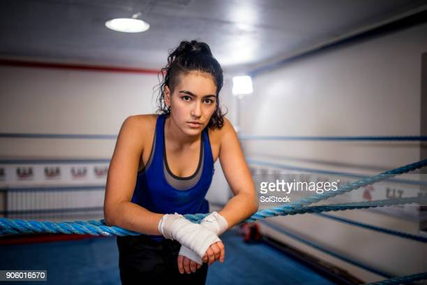 she feels at home in the boxing ring - tomboy stock photos and pictures