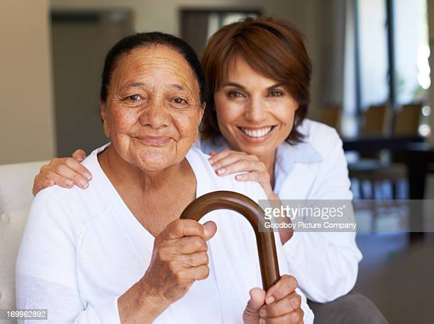 she feels safe and supported - walking cane stock photos and pictures