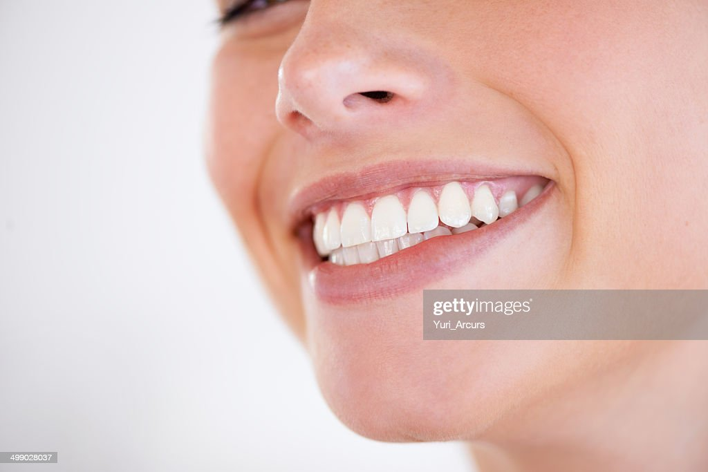 She has every reason to smile : Stock Photo