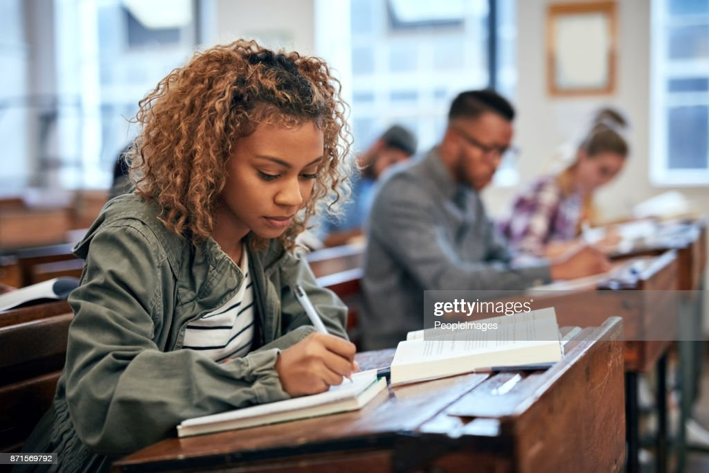 She is ready for the exam because she studied : Stock Photo