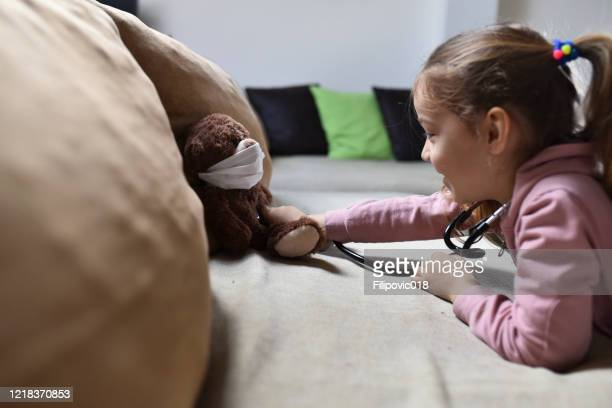 she is ready to save his friends from the virus. - illness prevention stock pictures, royalty-free photos & images