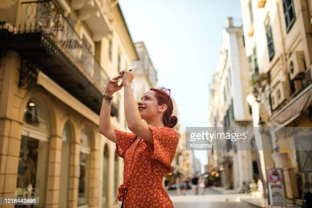 she is so amazed by the beautiful architecture of the old city - old town stock pictures, royalty-free photos & images
