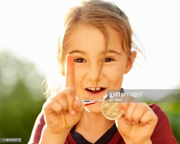 she is the soccer champ - medal stock pictures, royalty-free photos & images