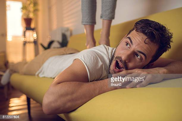 she is too heavy to stand on my back! - massage parlour stock photos and pictures