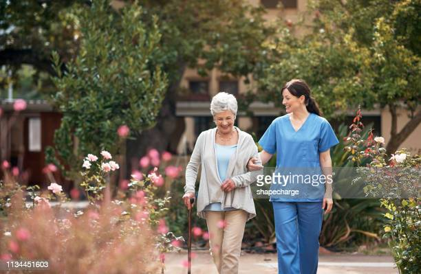 she knows just how to make each patient feel special - care stock pictures, royalty-free photos & images