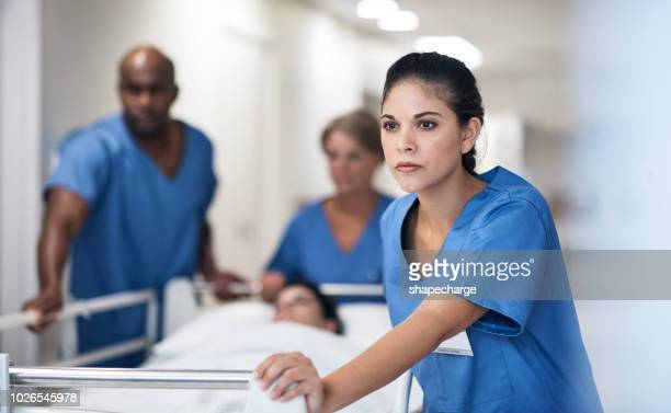 she knows that life is in her hands - hospital gurney stock pictures, royalty-free photos & images