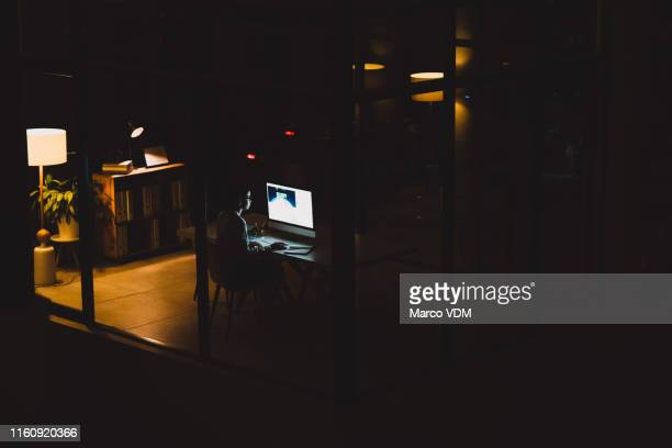 she knows that the extra hours will lead to greatness - working late stock pictures, royalty-free photos & images