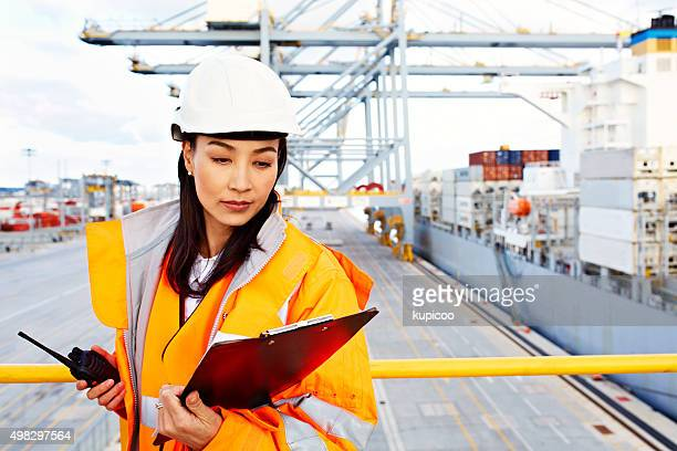 she knows where everything is on this pier! - loader reading stock pictures, royalty-free photos & images