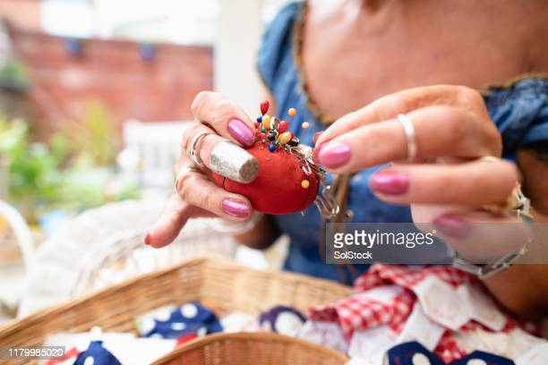 she likes her pin cushion - sewing stock pictures, royalty-free photos & images