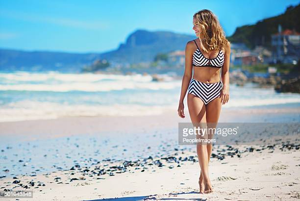 she likes long walks on the beach - swimwear stock pictures, royalty-free photos & images