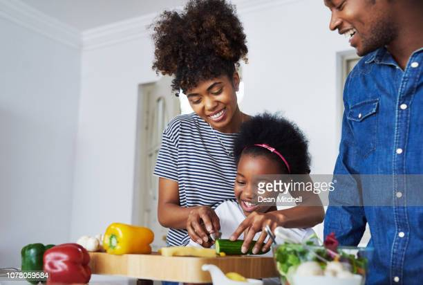she likes to be in the kitchen - dean foods stock photos and pictures