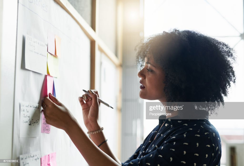 She likes to plan out her day : Stock Photo