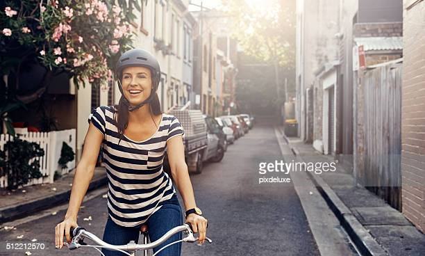 she loves cycling through the city - sports helmet stock pictures, royalty-free photos & images