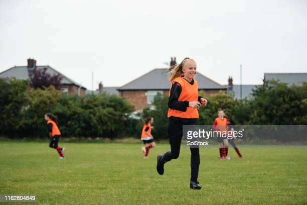 she loves football practice - athletics stock pictures, royalty-free photos & images